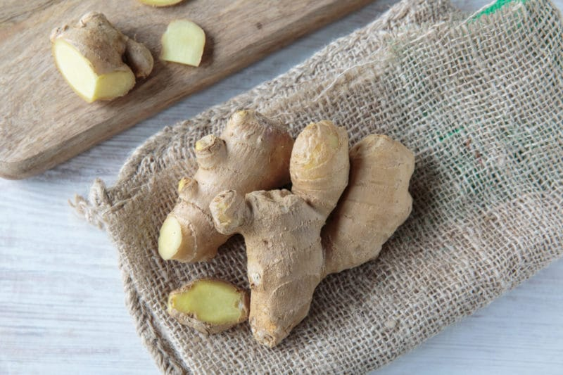 fresh ginger root on a burlap napkin