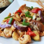 Szechuan chicken and eggplant dish on a white plate