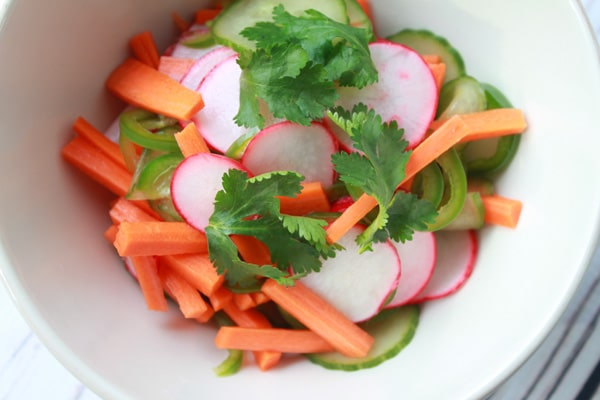 a bowl of fresh pickled vegetables topped with cilantro