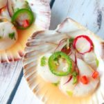 spicy scallop ceviche presented in a shell bowl