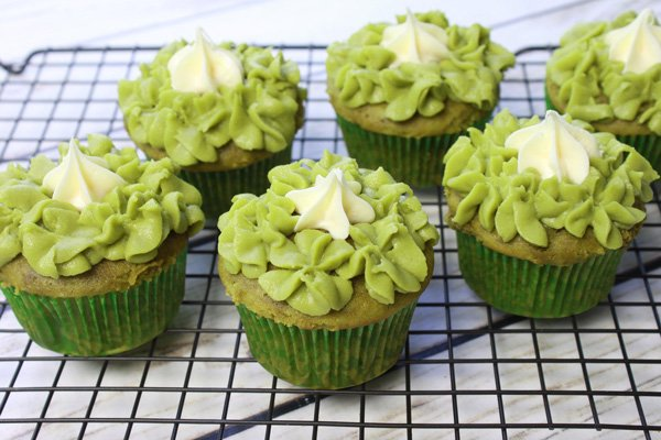 matcha green tea cupcakes on a baking rack