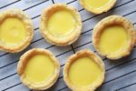 Chinese egg custard tarts on a cooling rack