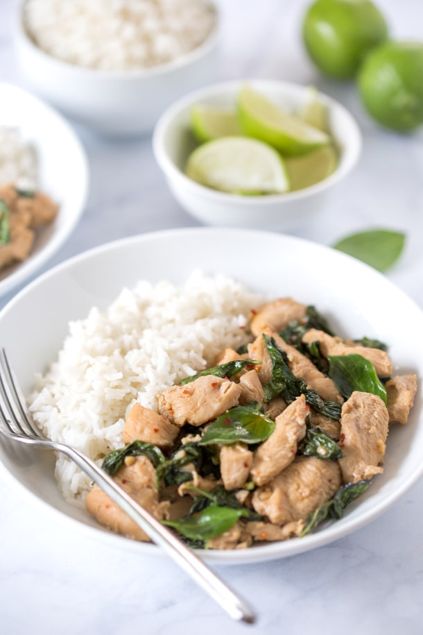 Thai basil chicken in a white bowl with white rice