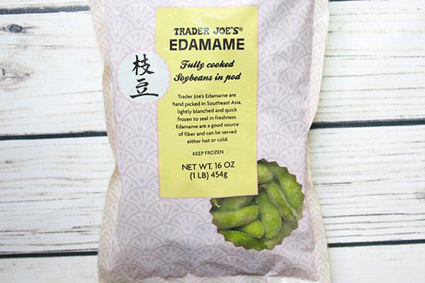A 16-ounce bag of Trader Joe's frozen edamame on a white board
