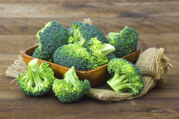 broccoli florets in a brown bowl