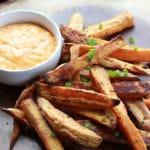 crispy baked sweet potato fries with spicy aioli dipping sauce