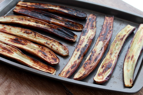 charred Chinese eggplant on baking tray