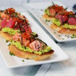 sushi grade tuna and salmon on avocado toast