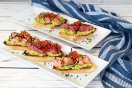 sushi grade salmon and tuna on avocado toast