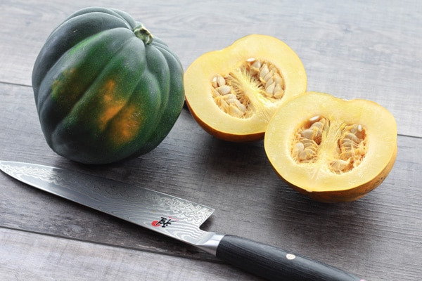 acorn squash sliced in half with knife
