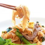 Thai Pad See Ew stir fried noodles with chopsticks