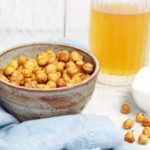 crispy spicy chickpeas in a bowl with a cold beer