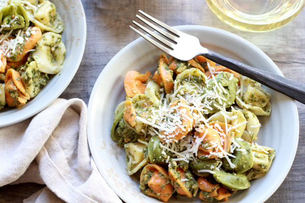 Tri-color tortellini in a bowl with Thai pesto sauce