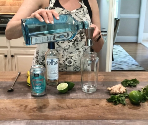 making ginger mint fizz cocktail with Bombay gin