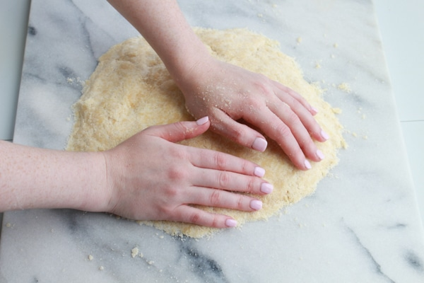 kneading dough on a pastry board for Chinese almond cookies