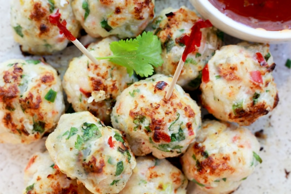 spicy baked shrimp balls with party toothpicks and a side of sweet chili sauce