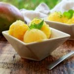 mango coconut sorbet in white bowls