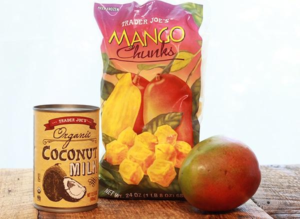 ingredients for mango coconut sorbet on a wood board