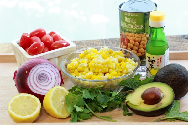 ingredients for corn and avocado salad on a board