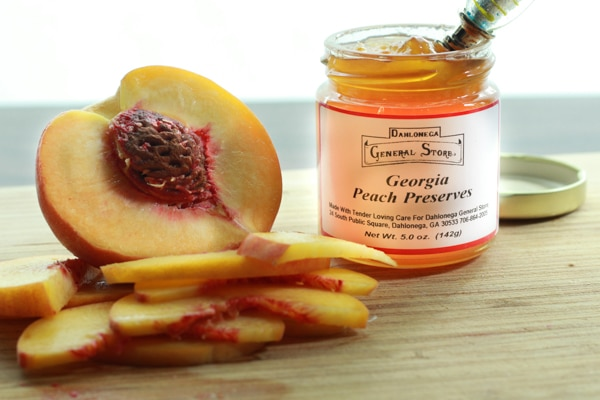 Fresh peaches along side Georgia peach preserves