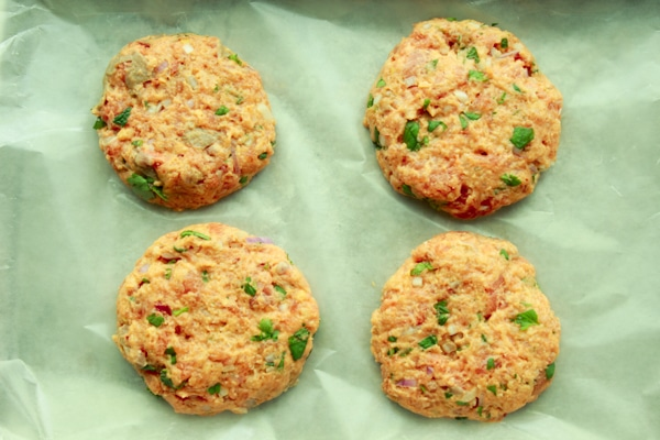 raw salmon burgers on waxed paper