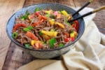 Colorful Japanese soba noodle salad in a large bowl with chopsticks