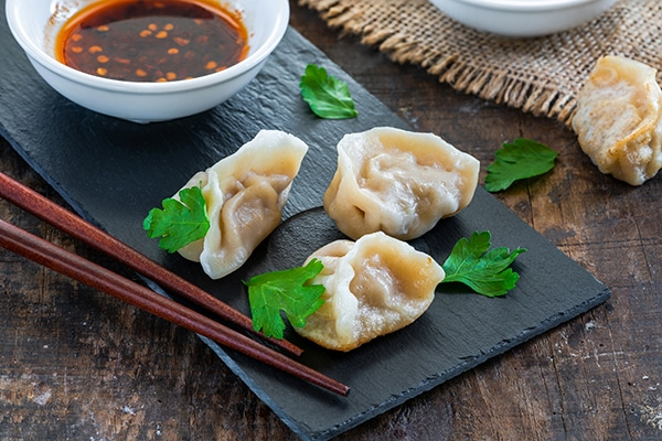 Chinese shrimp and pork dumplings - dim sum - with sweet chili dipping sauce