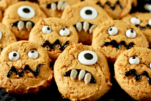 pumpkin monster cookies on a black background