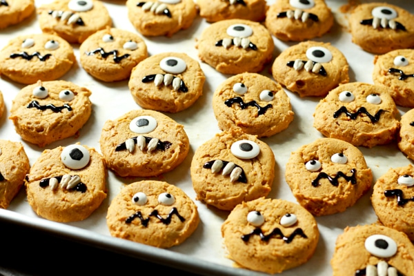 pumpkin monster cookies on a baking sheet