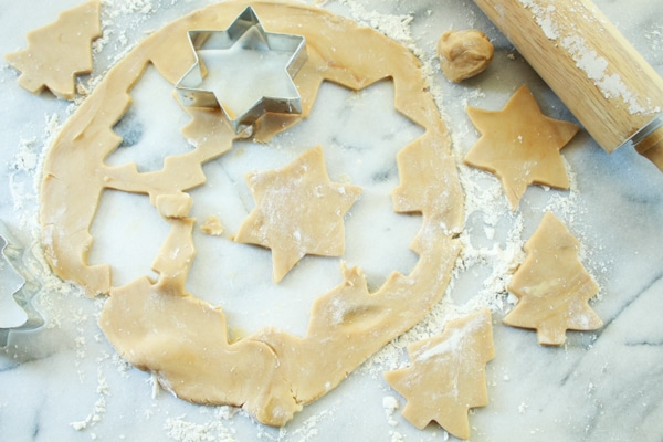 sugar cookie holiday cutouts on a pastry board