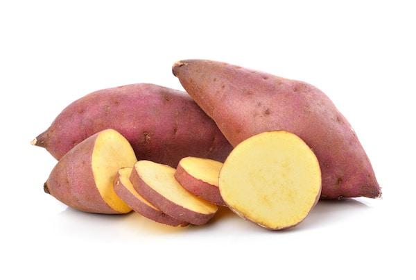 white sweet potatoes sliced on a white background