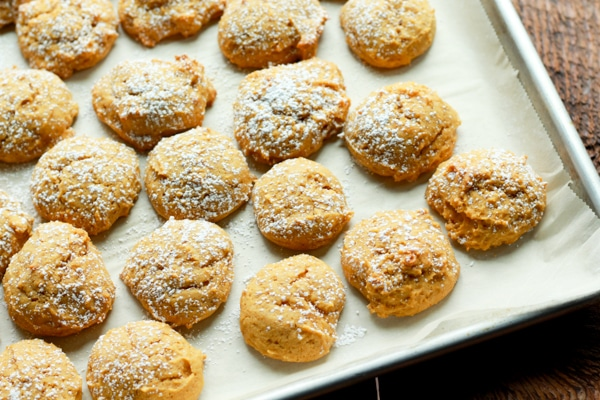 pumpkin spice cookies on a parchment-lined baking tray