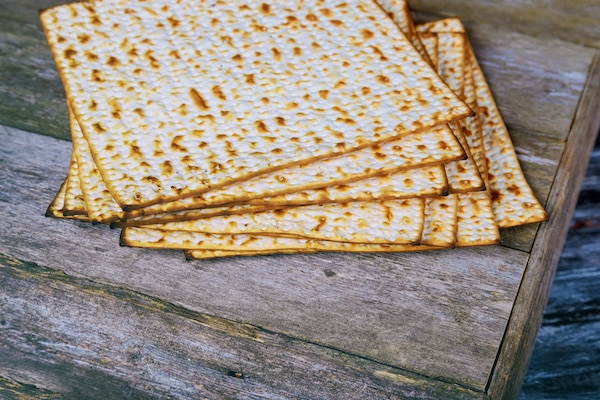 A stack of matzah on top of a wooden table