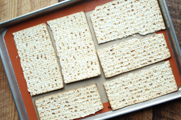 pieces of matzo on a baking tray