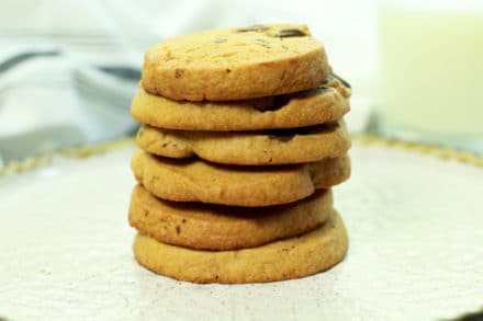 a stack of miso chocolate chip cookies on a white plate