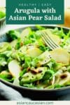 a vibrant Asian Pear salad in a bowl with a fork