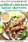 Tender satay chicken pieces cooked on wooden skewers on a white plate with a side of peanut sauce and fresh lime wedges