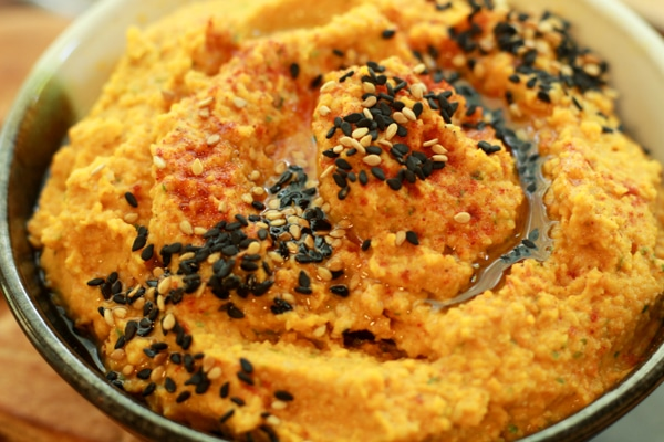 close-up of a bowl of roasted carrot and ginger hummus