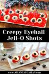 creepy lychee eyeballs on top of red jello and in small white tasting spoons