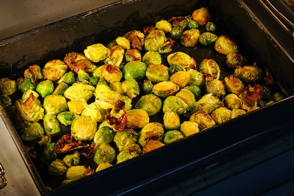 Roasted Brussels sprouts on a tray in the oven