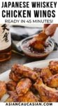 Saucy Japanese whiskey chicken wings on a white platter.