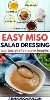 A woman's hand holding a spoon over a white bowl of homemade miso dressing with a bowl of greens and a blue napkin in the background on a white board, and miso dressing ingredients on a white board.