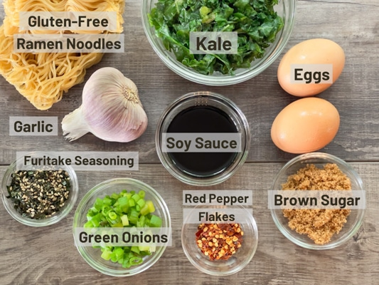 Labeled ingredients on a board for making the TikTok ramen recipe.
